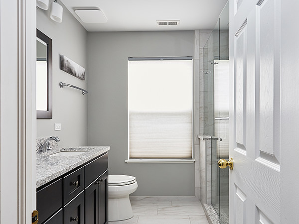 Cool Changes in these Aurora Bathrooms by J&J Construction