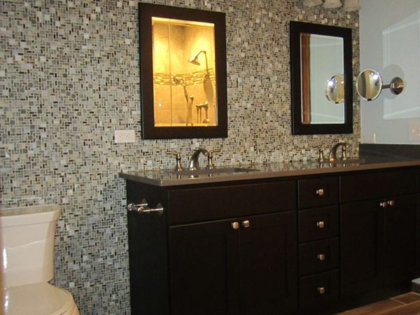Master bathroom with mosaic tile wall